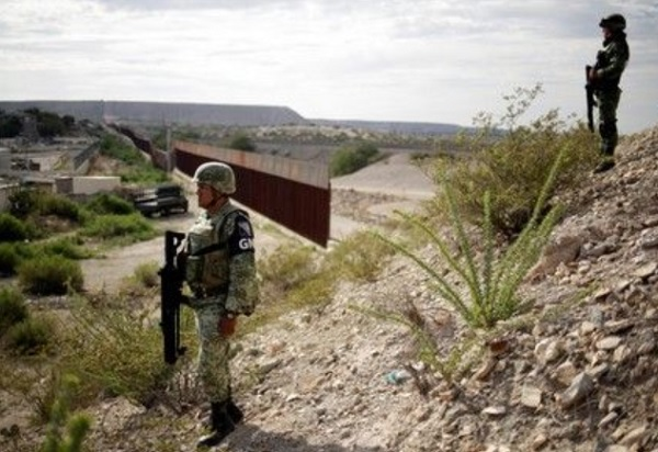 Mexico expects relief on U S  tariff threat as migrant flows