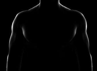silhouette shot of a shirtless man